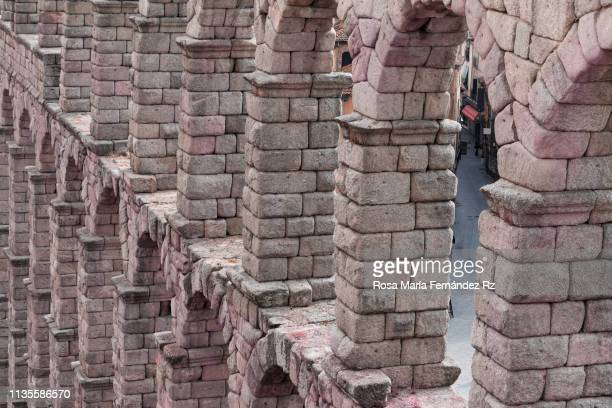 view of ancient roman architecture of the roman aqueduct of segovia, castilla y leon, spain - segovia stock pictures, royalty-free photos & images