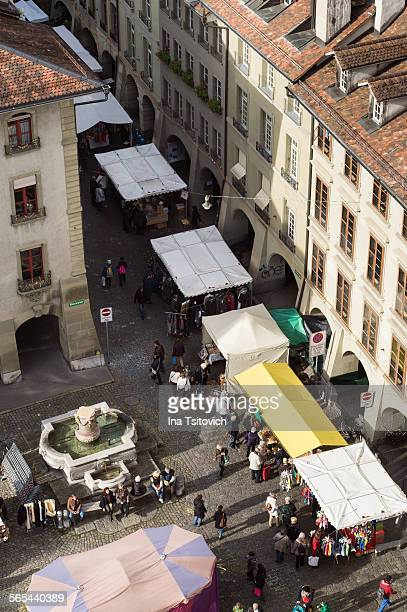 view of annual onion market in bern from cathedral - bern stock pictures, royalty-free photos & images