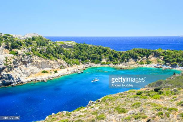 view of anthony quinn bay near faliraki village, rhodes, greece - rhodes dodecanese islands stock photos and pictures