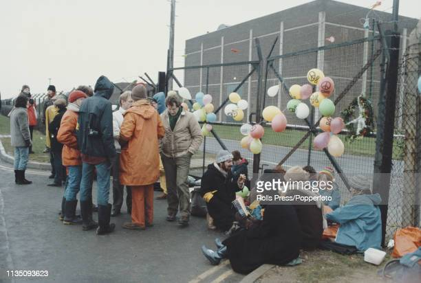 View of anti nuclear protesters and Campaign for Nuclear Disarmament supporters pictured blocking an entrance gate to RAF Upper Heyford base near...