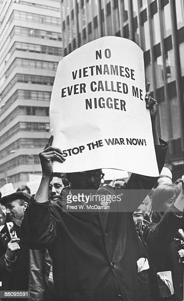View of antiVietnam War demonstrators as they march from Central Park towards United Nations Plaza New York New York April 15 1967 One protestor's...
