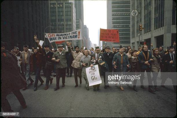 View of antiVietnam war protestors as they march along a street New York 1960s Among visible signs 'GI's Against the War in Vietnam' 'Free Speech for...