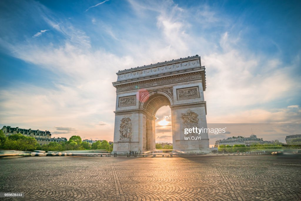 View of arc de Triomphe in Paris at sunset. : Stock Photo