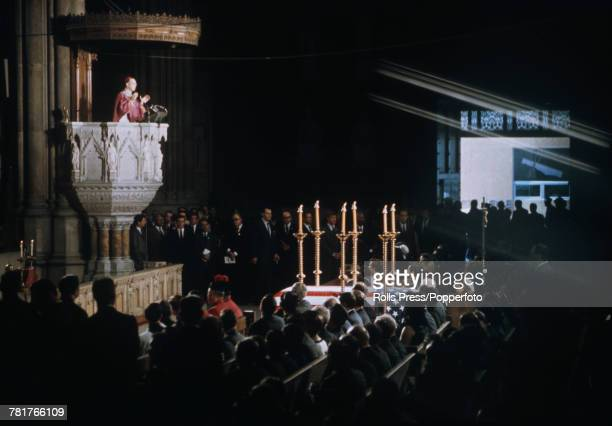 View of Archbishop of New York Terence Cooke blessing the casket containing the body of assassinated Senator Robert F Kennedy in Saint Patrick's...