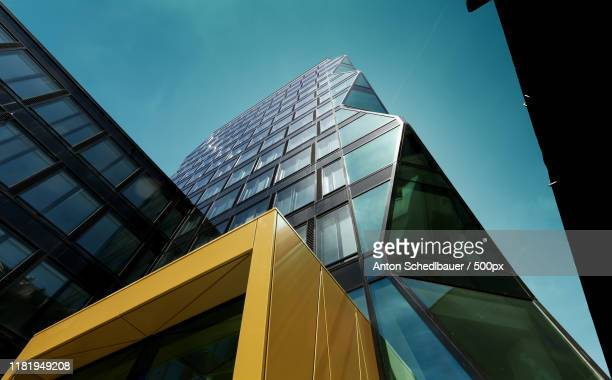 view of architectural buildings from below - anton schedlbauer stock-fotos und bilder