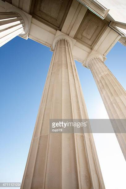 view of architectural pillars against blue sky - politics abstract stock pictures, royalty-free photos & images