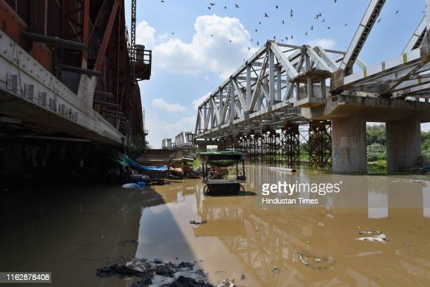 A view of areas submerged by the rising waters of the Yamuna River at Old Iron Bridge on August 20 2019 in New Delhi India Around 14000 people living...