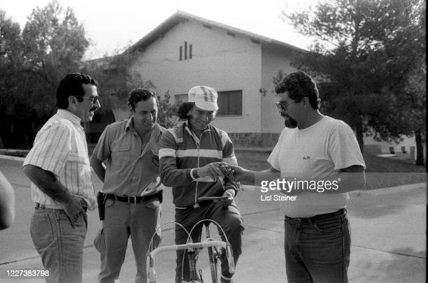 View of Argentinean politician Governor of La Rioja Carlos Menem on his bicycle as he signs an autograph Argentina 1988