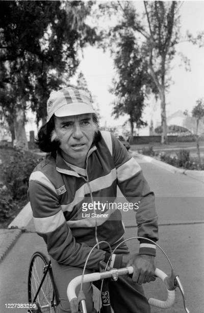 View of Argentinean politician Governor of La Rioja Carlos Menem with his bicycle as he speaks outdoors Argentina 1988