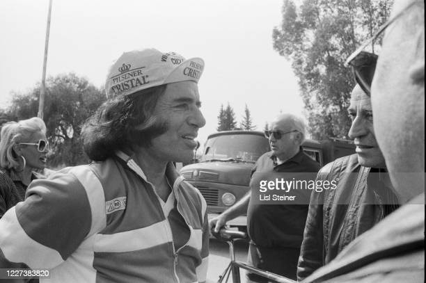 View of Argentinean politician Governor of La Rioja Carlos Menem with his bicycle as he speaks with bystanders Argentina 1988