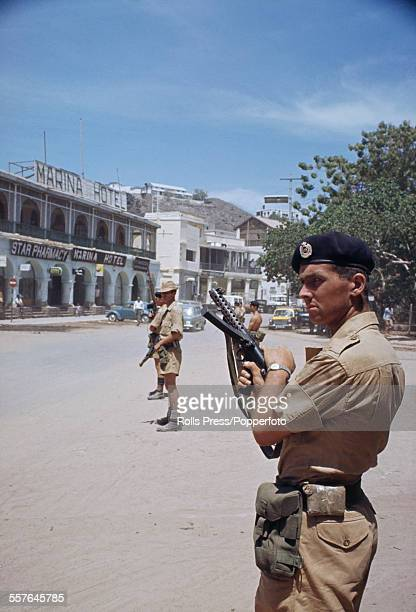 View of armed British soldiers on patrol on the streets of Aden town following a period of unrest and rioting during the Aden Emergency in 1967