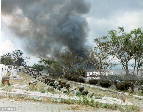 View of Army of the Republic of Viet Nam soldiers as they take cover in the old French cemetery during operations in the Tet Offensive Saigon Vietnam...