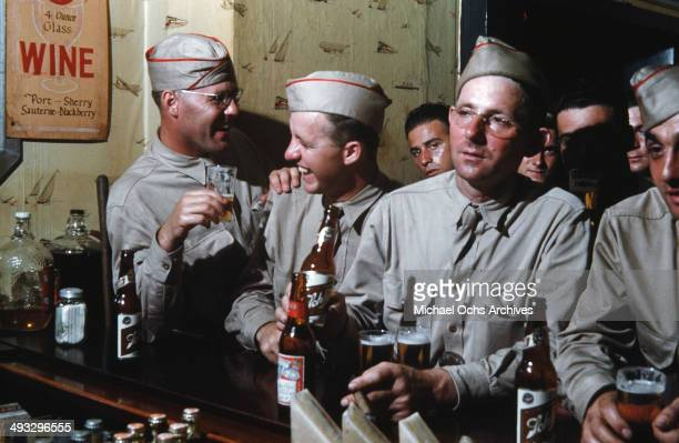 View of army soldiers off duty drink beer at a local bar in Fayetteville, North Carolina in 1942.