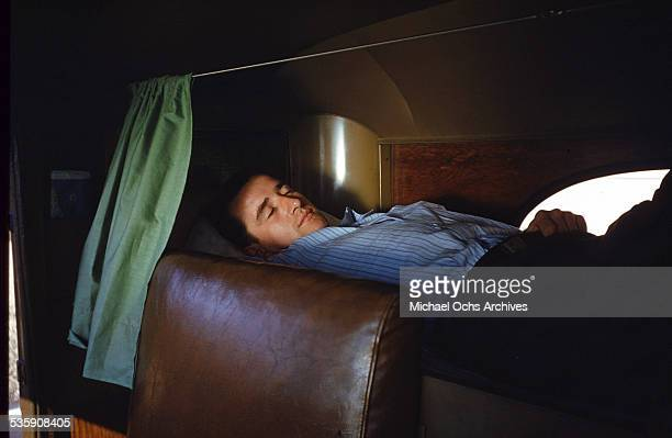 A view of as a truck driver sleeps in his Mack Truck for Cooper Jarrett Motor Freight Lines in Illinois