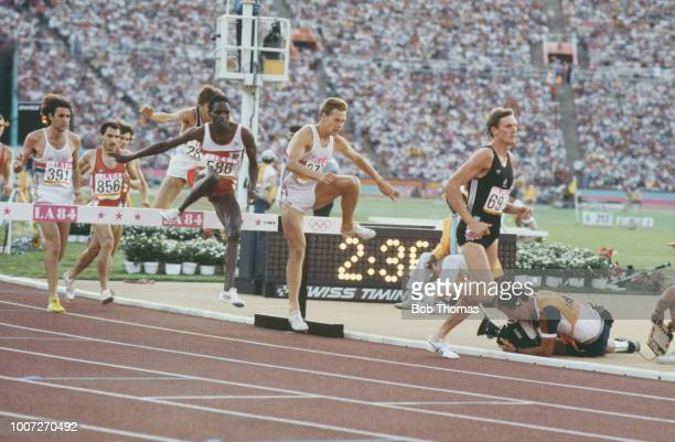 View of athletes clearing a hurdle hazard with from right Peter Renner of New Zealand Roger Hackney of Great Britain eventual winner Julius Korir of...