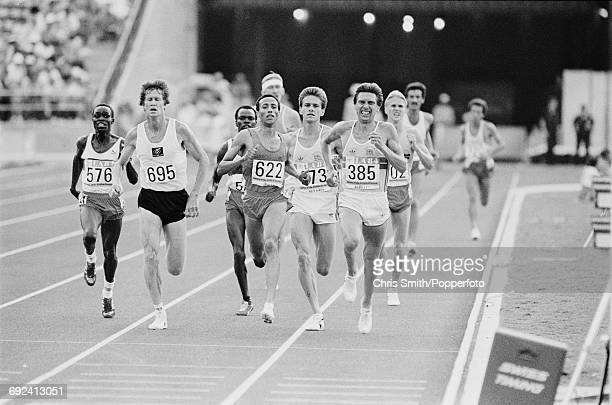 View of athletes competing in the final of the Men's 5000 metres event with from left Charles Cheruiyot of Kenya John Walker of New Zealand gold...