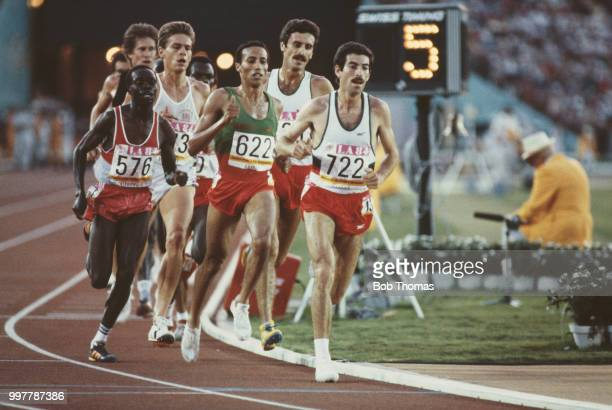 View of athletes competing in the final of the Men's 5000 metres event with from left Charles Cheruiyot of Kenya Tim Hutchings of Great Britain...