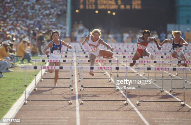 View of athletes competing in the final of the Women's 100 metres hurdles event with from left MarieNoelle Savigny of France silver medallist Shirley...