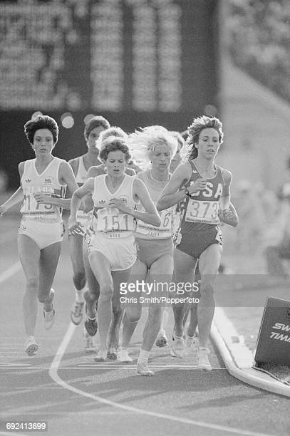 View of athletes competing in the final of the Women's 3000 metres event with from left Wendy Sly of Great Britain Zola Budd of Great Britain running...