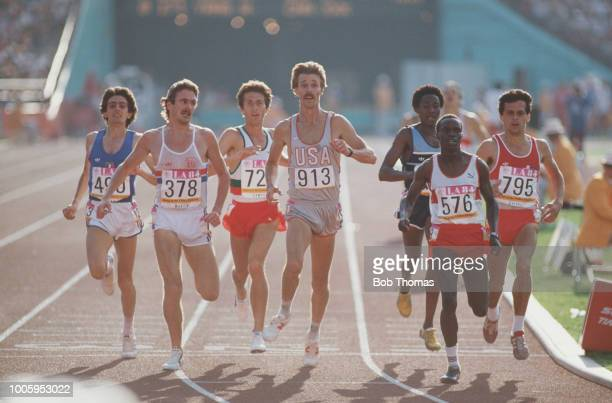 View of athletes crossing the finish line at the end of heat 3 of the Men's 5000 metres event inside the Memorial Coliseum at the 1984 Summer...