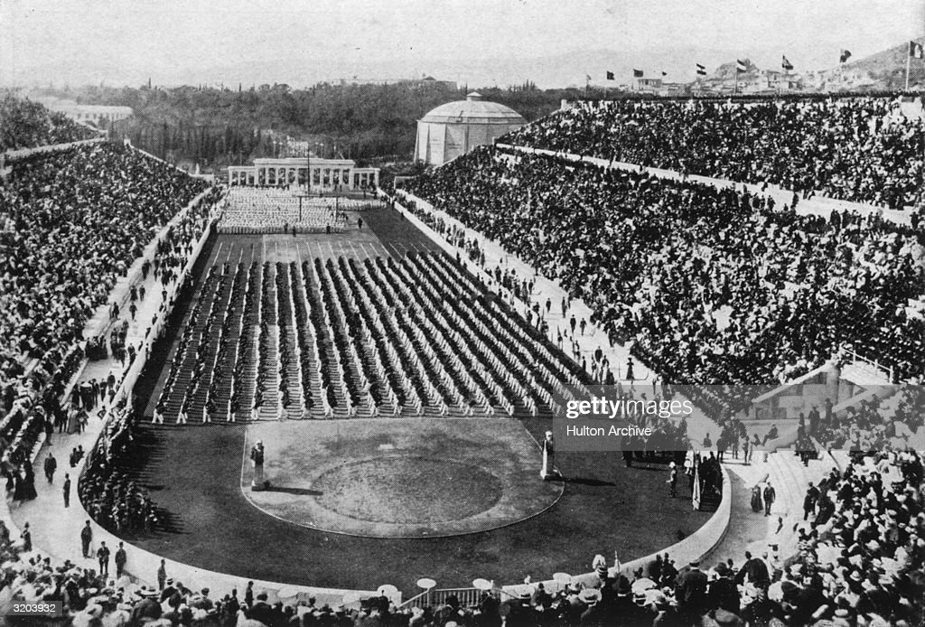View of athletes, standing in rows, and crowds filling the stadium at the 1896 Olympic Games in Athens, Greece.