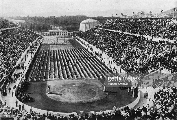 View of athletes standing in rows and crowds filling the stadium at the 1896 Olympic Games in Athens Greece