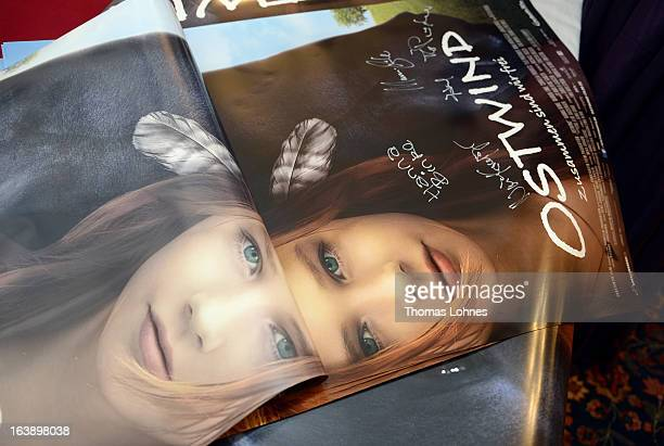A view of atmosphere during the premiere of the film Ostwind autographs on the film poster on March 17 2013 in Frankfurt am Main Germany The family...
