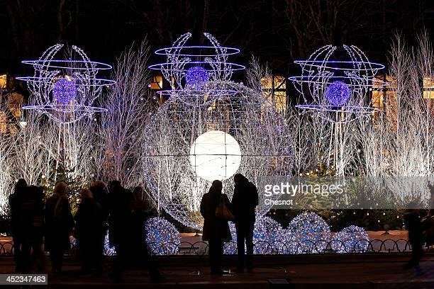 A view of atmosphere of the Paris Christmas illuminations at the Champs Elysees on November 27 2013 in Paris France Until January 8 Parisians and...