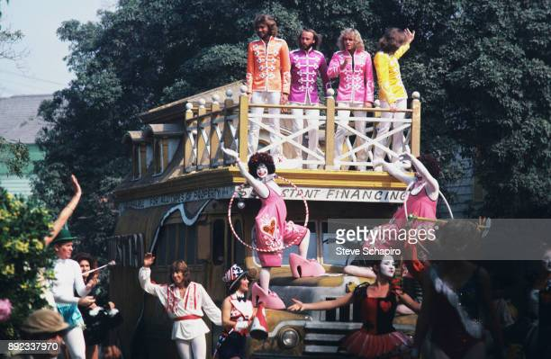 View of atop bus from left musicians Barry and Maurice Gibb Peter Frampton and Robin Gibb in a scene from the film 'Sgt Pepper's Lonely Hearts Club...