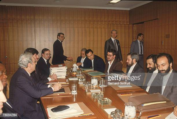 View of attendees as they sit around a conference table for peace talks during the IranIraq war 1980s They are probably at the United Nations...