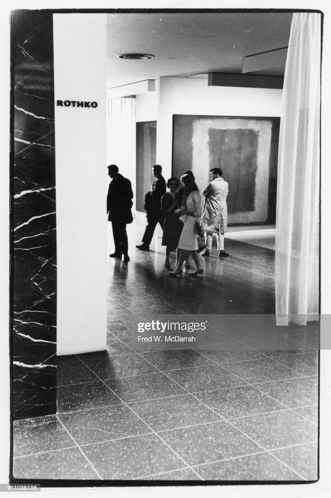 View of attendees at an exhibition of Mark Rothko's work at the Museum of Modern Art, New York, New York, February 25, 1961 Among those pictured is American painter Clyfford Still (1904 - 1980) (right).