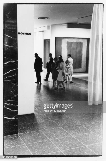 View of attendees at an exhibition of Mark Rothko's work at the Museum of Modern Art New York New York February 25 1961 Among those pictured is...