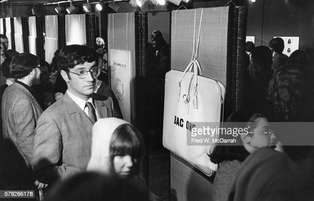View of attendees at the Lee Nordness Gallery for the 'Wedded Bliss' show of John Lennon's lithographs February 7 1970 The lithographs created as a...