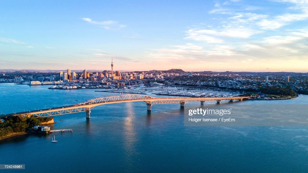 View Of Auckland City At Waterfront Against Cloudy Sky : Stock Photo