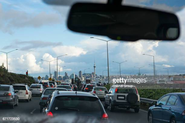 View of Auckland skyline from a car sitting in traffic.