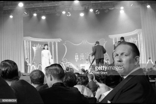 View of audience members in Boardwalk Hall during the Miss America beauty pageant, Atlantic City, New Jersey, September 7, 1968. A man with a cigar...