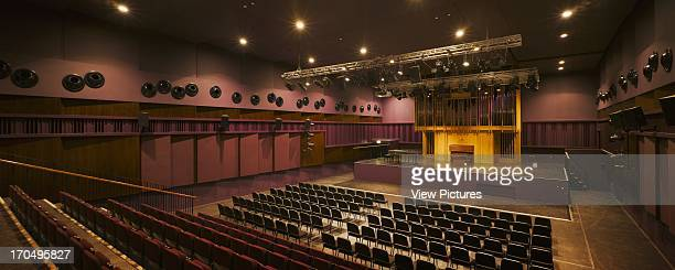 View of auditorium showing adjustable acoustic wall paneling stage and seating The Cork School of Music Music School Europe Ireland Cork Murray...