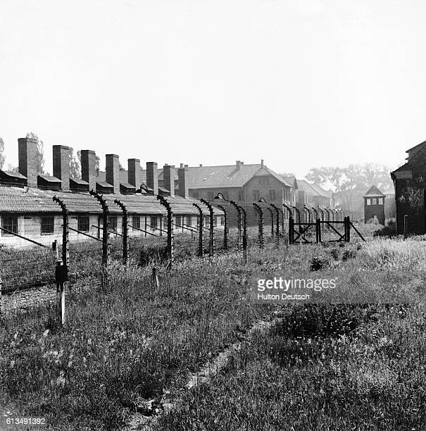 View of AuschwitzBirkenau concentration camp Two rows of barbed wire encircle the camp The path between could be easily machinegunned from the watch...