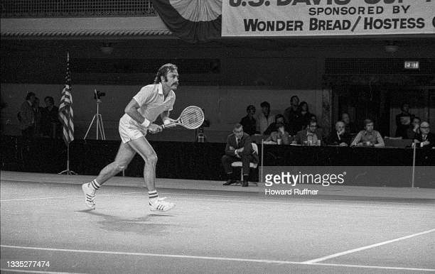View of Australian tennis player John Newcombe in action during a match on the first day of the 62nd Davis Cup final, Cleveland, Ohio, November 30,...