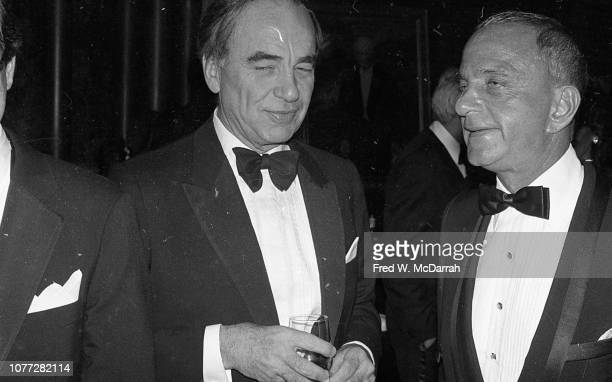 View of Australianborn American media executive Rupert Murdoch and attorney Roy Cohn during Cohn's birthday party at the Seventh Regiment Armory New...
