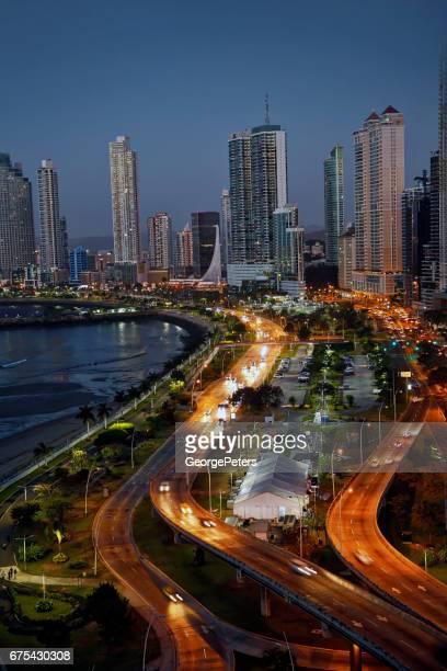 view of avenida balboa at sunset. panama city, panama - panama city panama stock pictures, royalty-free photos & images