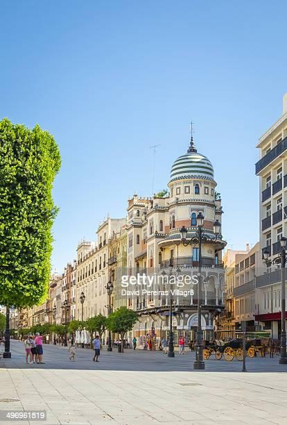 View of Avenida de la Constitucion in Seville, with the famous and eclectic Adriatica building, in Andalusia, Spain