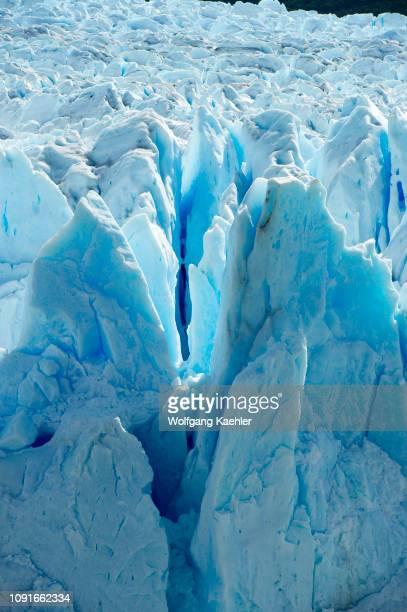 View of backlit crevasses of the Perito Moreno glacier at Lago Argentino in Los Glaciares National Park near El Calafate Patagonia Argentina