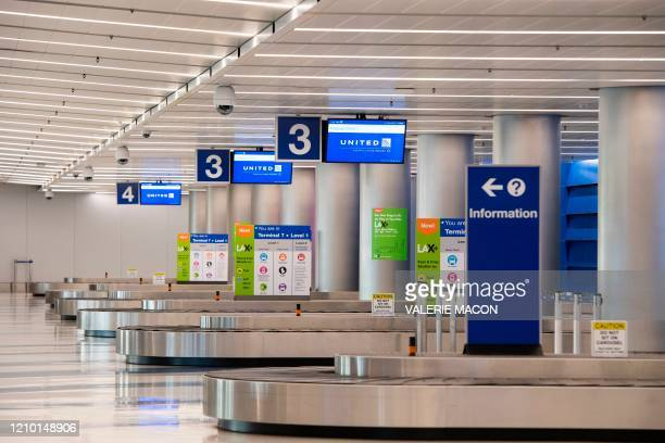 A view of baggage claim at the United Airlines terminal at Los Angeles International Airport during the outbreak of the novel coronavirus which...