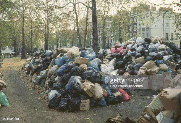 View of bags of rubbish refuse and commercial waste piling up in Berkeley Square in London during a strike by dustmen and refuse collectors in the...
