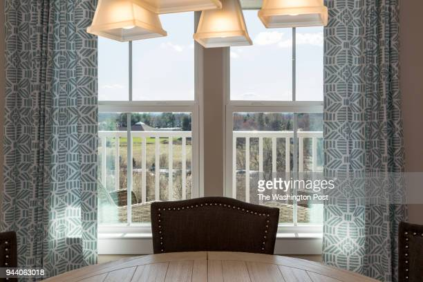 View of Balcony from Dining Area in the Penthouse model at Ellicotts Retreat on April 4 2018 in Ellicoot City Maryland