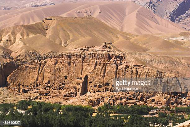 View of Bamiyan valley showing cliffs with empty niche where famous carved Buddha once stood