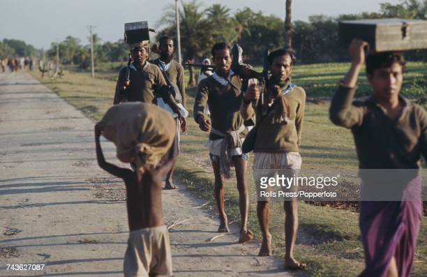 View of Bangladesh liberation troops with light automatic weapons marching along a road at Satkhira near the Indian border where fighting involving...