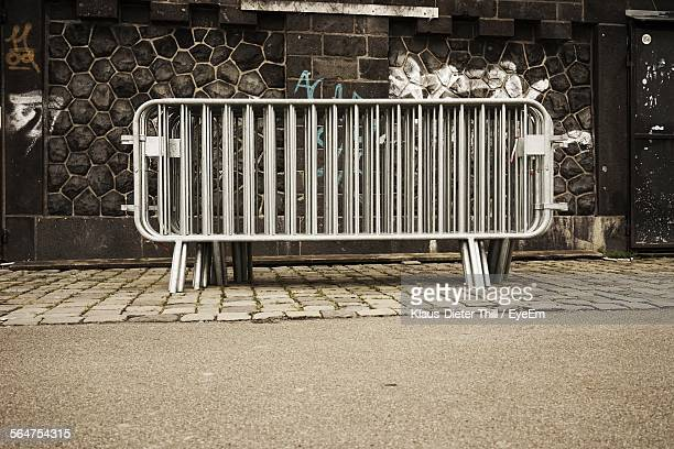view of barricades on footpath - barricade stock photos and pictures