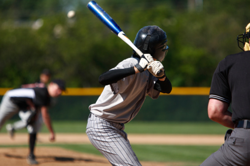 View of baseball batter from behind the catcher as they hit 136940720